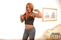 Redhead ebony TS in ass hugging jeans