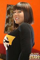 Buxom ebony tgirl posing in tight dress