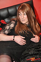 Mature Shemale In Stockings On Bed