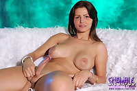 Gorgeous brunette shows cock in the couch
