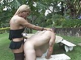 Lovely tranny fucks tattooed stud outdoors