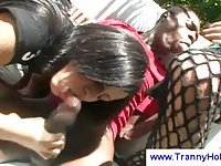 Two kinky trannies blowing a black guy