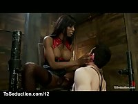 Black tranny fucks bound guy in mouth and canes him