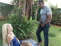 Body builder drills skinny blonde outdoors