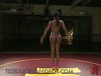 Busty black tranny in pink bikini sucks and fucks guy on mats