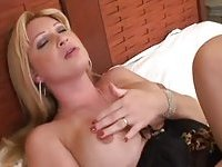 Non-stop blonde with big boobs & cock jerks off on the bed