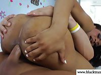 Nubian tranny gets jizzed over her tits