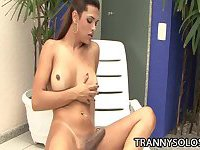 TS Taina Loussda strokes her smooth cock