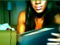 Lonely chocolate tranny pleases herself