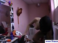Ebony transsexual shows her tanning lines to the cameraman