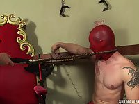 Kalena Rios in red latex with a whip teaching a guy a lesson