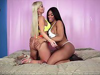 Blonde and Ebony Shemales fucking each other