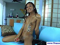 Nubian shemale plays with her big cock