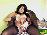 Latin tranny in stockings stroking her cock