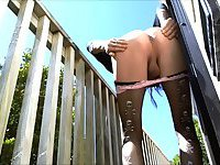 Slim CD outside exploring ass with dildo