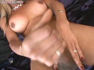 Ebony ladyboy is playing withher huge cock!