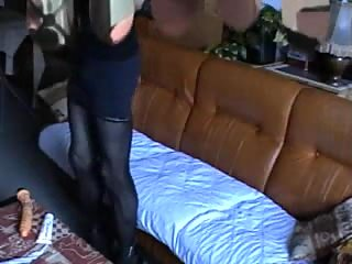 Dirty crossdresser plays on a sofa