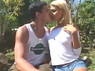 Blonde shemale and two guys outdoors