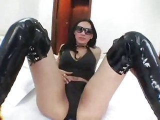 Brunette Tranny In Latex Boots