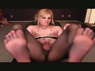 Smoking blonde TS showing her feet