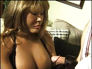 Interracial mutual fuck with a busty TS milf