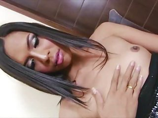 Exotic shemale beauty Nicole teases and masturbates in solo