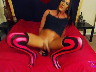 Hot long legged shemale takes huge toys
